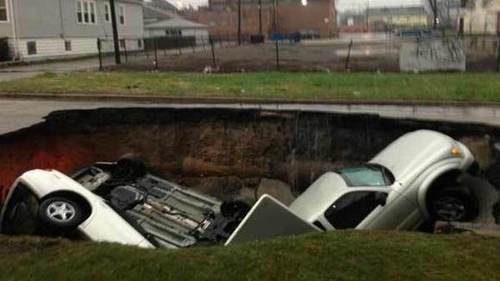 One Person Hospitalized After Sinkhole Swallows Three Cars
