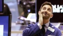 Dow Passes 16,000 for First Time
