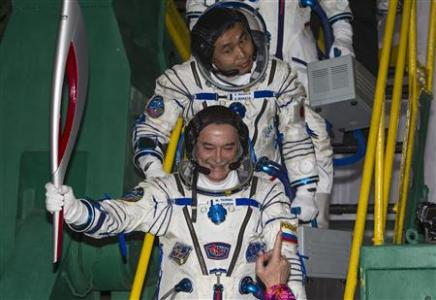 Russia sends Olympic torch, 3 astronauts to ISS