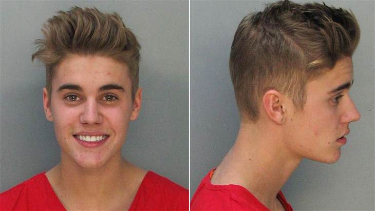 Check Justin Bieber Smiley Mug Shot [PICTURE]