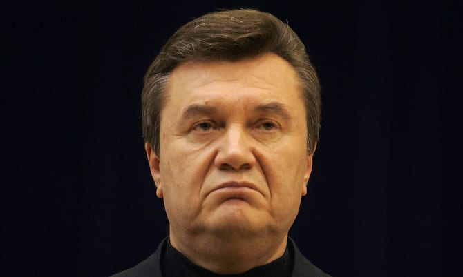 Ukrainian PM and Moscow-backed presidential candidate Yanukovich listens to questions during news ...