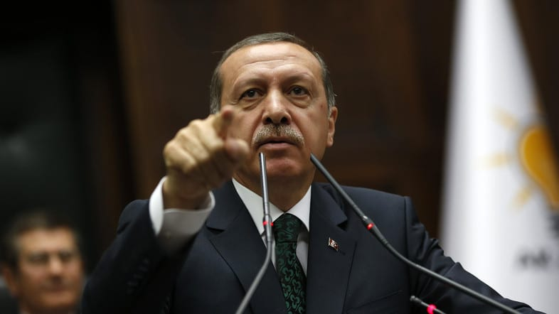 Turkey's PTurkey blocks access to Twitterrime Minister Tayyip Erdogan addresses members of parliament from his ruling AK Party during a meeting at the Turkish parliament in Ankara