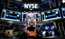 US stocks rise after Fed statement; record finish for Dow