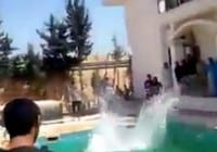 Libyan Militants Hold Pool Party at Abandoned U.S. Embassy [VIDEO]