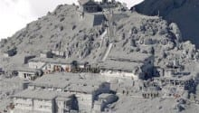 Officials begin to recover bodies from peak of Japan volcano