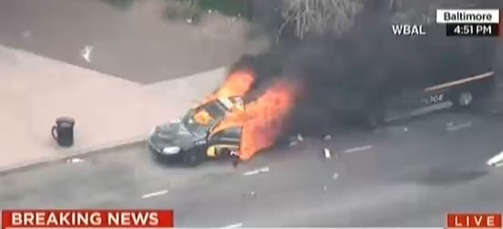 Baltimore police car on fire