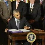 Obama signs trade, worker assistance bills into law
