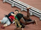Usain Bolt is floored by cameraman at World Championships in Beijing [VIDEO]